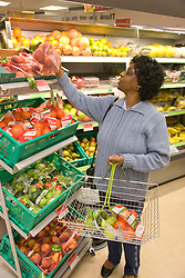 Older woman selecting fruit in a supermarket,
