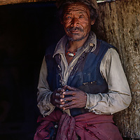 A villager stands in his hut in Kagbeni, Nepal, on the border of Mustang.