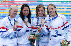 26-09-2009 SWIMMING: FINA WORLD CHAMPIONSHIPS: ROMA<br /> Marleen Veldhuis, Inge Dekker, Ranomi Kromowidjojo, Femke Heemskerk  of team Netherlands at medal ceremony after they won in the Women's 4x 100m Freestyle Final<br /> ©2010-WWW.FOTOHOOGENDOORN.NL