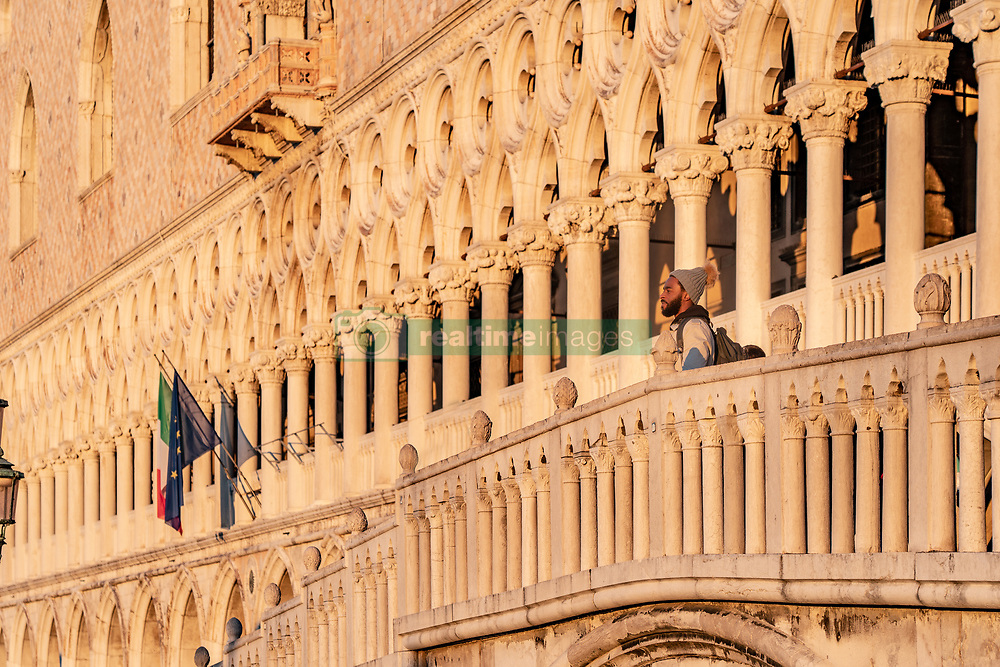 A man looks out from the bridge in front of the Doge's Palace in Venice at sunrise. From a series of travel photos in Italy. Photo date: Tuesday, February 12, 2019. Photo credit should read: Richard Gray/EMPICS