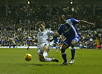 Photo: Andrew Unwin.<br />Leeds United v Cardiff City. Coca Cola Championship.<br />10/12/2005.<br />Cardiff's Cameron Jerome (R) battles with Leeds' Paul Butler (L).