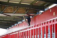 Ground shot of the videographer in an otherwise empty stand during the EFL Sky Bet League 2 match between Stevenage and Bradford City at the Lamex Stadium, Stevenage, England on 5 April 2021.