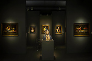 The Virgin of Solitude (1660's) with St James the Lesser by El Greco (behind) in the Caylus Gallery - Frieze Masters 2014 - including a huge range of works from religious relics, through old masters to contemporary art with prices upto millions of pounds. Regents Park, London, 14 Oct 2014.