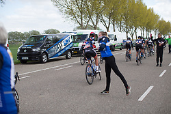 Team WNT soigneur Jessie Walker gives a bottle to Hayley Jones (GBR) before her crash in the third lap of the Omloop van Borsele - a 107.1 km road race, starting and finishing in s'-Heerenhoek on April 22, 2017, in Borsele, the Netherlands.