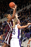 Texas A&M forward Danielle Gant (L) scores two of her team high 10 points in the first half over Kansas State forward Danielle Zanotti (R) at Bramlage Coliseum in Manhattan, Kansas, January 6, 2007.  K-State upset the 17th ranked Aggies 48-45.