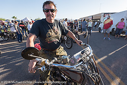 Master mechanic Ziggy Dee on Sharon Jacob's 1915 HD along with other bikes on display in downtown Lake Havasu City, Arizona where their Convention and Visitors Bureau hosted a dinner for the riders during the Motorcycle Cannonball Race of the Century. Stage-13 ride from Williams, AZ to Lake Havasu City, AZ. USA. Friday September 23, 2016. Photography ©2016 Michael Lichter.