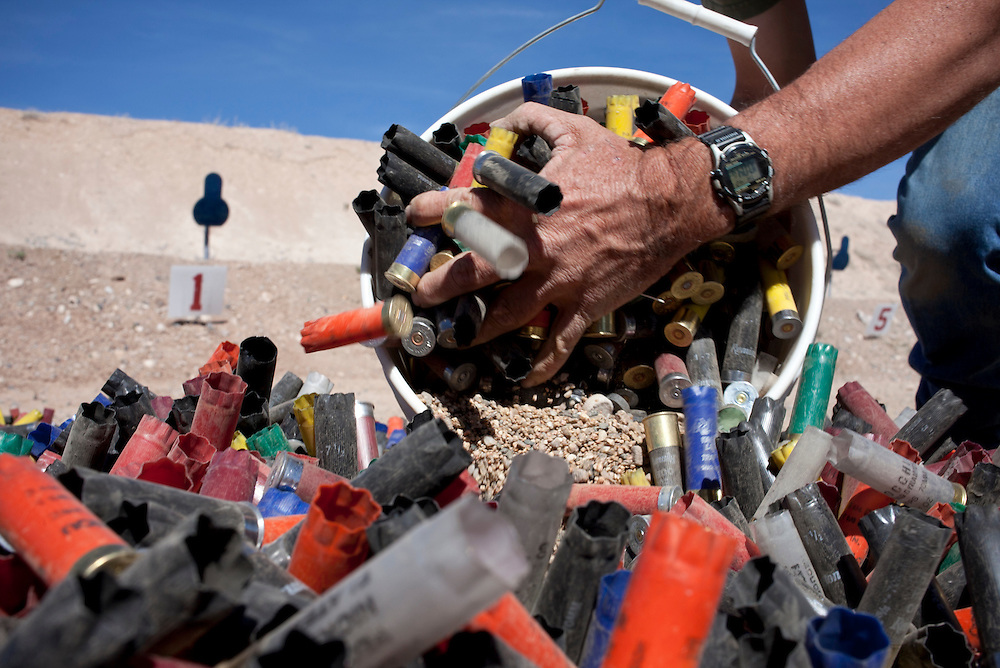 Employees pick up shotgun shells on the Shotquad.  Gunsite Academy is the world's oldest and largest firearms training facility.