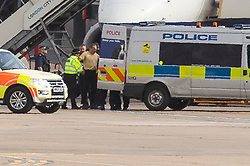 © Licensed to London News Pictures. 10/10/2019. London, UK. An Extinction Rebellion protester is removed from a British Airways plane and placed in a police van at London City Airport . Photo credit: George Cracknell Wright/LNP