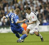 Photo: Aidan Ellis.<br /> Leeds United v Cardiff City. Coca Cola Championship. 19/08/2006.<br /> Cardiff's Darren Purse challenges Leeds Robbie Blake