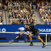 2019 US Open Tennis Tournament- Day Nine.  Roger Federer of Switzerland is passed by Grigor Dimitrov of Bulgaria in the Men's Singles Quarter-Finals match on Arthur Ashe Stadium during the 2019 US Open Tennis Tournament at the USTA Billie Jean King National Tennis Center on September 3rd, 2019 in Flushing, Queens, New York City.  (Photo by Tim Clayton/Corbis via Getty Images)
