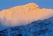 First light on snow of mountain peak of teh Canadian Rocky Mountains<br /> Jasper National Park<br /> Alberta<br /> Canada