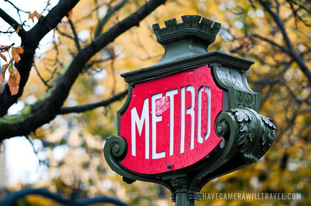 Old metro subway sign in Paris.