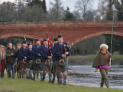 The traditional start to the salmon fishing season in Scotland took place on the River Tay at Meikleour near Kinclaven. Fishers from all over the country took part in the march to the river and blessing of the water before casting their lines. Singer Dougie MacLean made the first cast, and helped bless the water with malt whisky with Perth and Kinross Provost councillor Dennis Melloy.<br /> <br /> <br /> © Dave Johnston / EEm