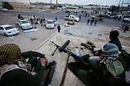 Rebels prepare for an attack on Sirt in Braga on the highway to Tripoli on March 4, 2011.