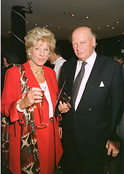 LORD & LADY HAMBRO, he is the banker, at a fashion show in London on April 30th 1997.LYA 27
