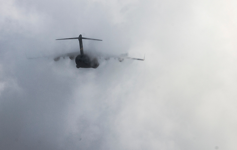 A C-17 Globemaster III disappears in clouds, while practicing formation flying, June 11, 2015 over South Carolina. Aircrews constantly train to maintain standards and qualifications to perform their mission while deployed. (U.S. Air Force photo by Staff Sgt. Perry Aston)(Not Reviewed)