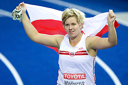 Poland's Anita Wlodarczyk celebrates her new world record 77,96m in the women's hammer throw final of the 2009 IAAF Athletics World Championships on August 22, 2009 in Berlin. (Photo by Vid Ponikvar / Sportida)