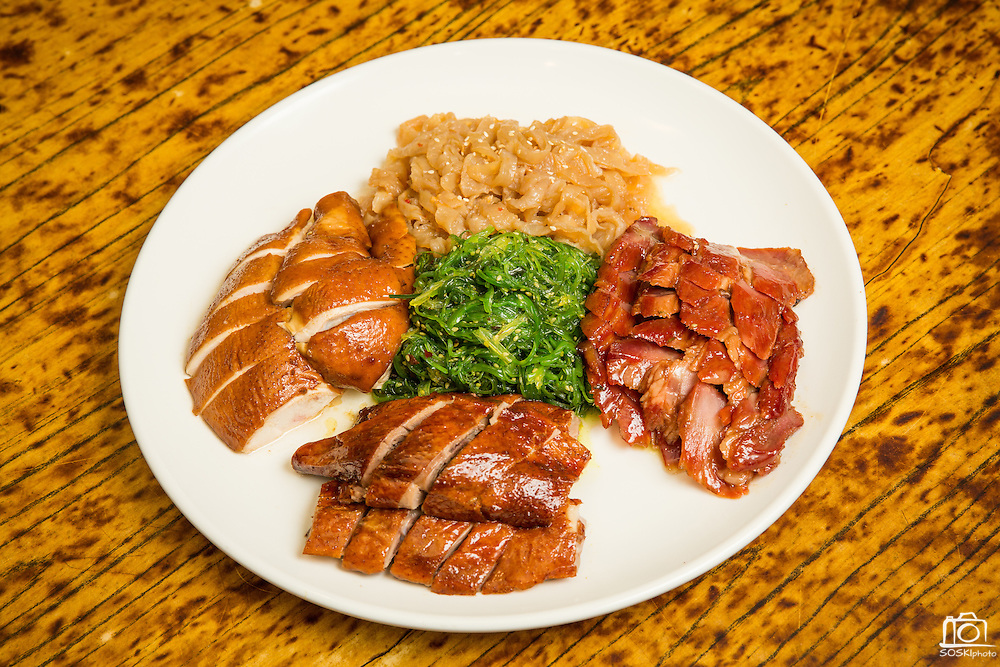 A combination plate of bbq pork, chicken, duck, and jellyfish is photographed at Great Mall Mayflower Restaurant in Milpitas, California, on September 11, 2014. (Stan Olszewski/SOSKIphoto)