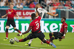 Real Madrid forward Karim Benzema strikes on target as Manchester United captain Eric Bailly (3) slides to block the shot during the first half during International Champions Cup action at Hard Rock Stadium in Miami Gardens, FL, USA on Tuesday, July 31, 2018. Manchester United won, 2-1. Photo by Sam Navarro/Miami Herald/TNS/ABACAPRESS.COM