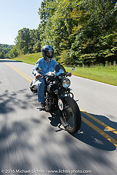 Dennis Leggett riding his 1936 Indian Sport Scout during Dennis Leggett riding his 1936 Indian Sport Scout during Stage 5 of the Motorcycle Cannonball Cross-Country Endurance Run, which on this day ran from Clarksville, TN to Cape Girardeau, MO., USA. Tuesday, September 9, 2014.  Photography ©2014 Michael Lichter.