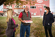 """14 OCTOBER 2020 - KNOXVILLE, IOWA: THERESA GREENFIELD, the Democratic candidate for US Senator from Iowa, (RIGHT) talks to SHARON SMITH and MAX SMITH at Smith Fertilizer and Grain. Greenfield toured Smith Fertilizer and Grain in Marion County and talked to owner Max Smith about her """"Fair Shot for Our Farmers"""" plan to improve Iowa's farm economy. Greenfield is in a tight race with incumbent Republican Senator Joni Ernst.     PHOTO BY JACK KURTZ"""