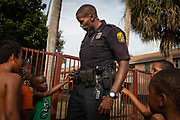 Officer Jerry Wyche of the Tampa Police Department interracts with kids in an effort to build community trust at the Robles Park apartments, a Tampa Housing Authority property, in Tampa, Florida, U.S., December 22, 2015.