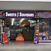 """U.S. sweets """"Sweets & Souvenirs"""" dominate Oxford Street on 2021-09-10, London, UK."""