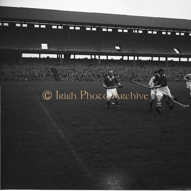 Cork player attempts a hit at the goal during The National Hurling League, Cork v Dublin in Croke park on the 15th November 1953.
