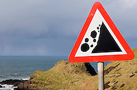 Falling rocks warning sign at The Giants Causeway in Antrim Northern Ireland
