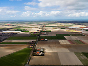 Nederland, Noord-Holland, Gemeente Wieringermeer, 16-04-2012. overzicht Wieringermeerpolder met Robbenoordweg , links wijkje van het dorp Wieringerwerf...Wieringmeer polder,  newly created land 1927, part of the Zuiderzee Works..luchtfoto (toeslag), aerial photo (additional fee required);.copyright foto/photo Siebe Swart