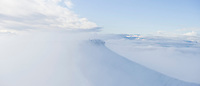 Summit of Corn Du emerges from clouds, Brecon Beacons national park, Wales