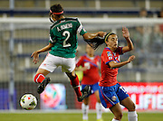 Mexico's Arianna Romero (2) goes up for the ball as Costa Rica's Melissa Herrera (17) defends during the first half of a CONCACAF Women's Championship soccer match, Thursday, Oct. 16, 2014, in Kansas City, Kan. (AP Photo/Colin E. Braley)