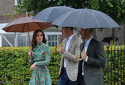 The Duke and Duchess of Cambridge and Prince Harry arrive for a visit to the White Garden in Kensington Palace, London and to meet with representatives from charities supported by Diana, the Princess of Wales.