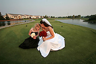 Photographer: Kevin Bartram.Senft-Kreutzinger 06-27-2008.Mayumi Senft shares a quiet moment with a flower girl on the golf course at The Nines in Brentwood, California.
