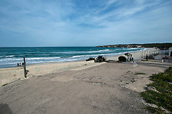 Torre dell'Orso è una località balneare del Salento, marina di Melendugno, in provincia di Lecce. Nota per l'ampia spiaggia di finissima sabbia color argento, Torre dell'Orso vanta un mare particolarmente limpido per le correnti del Canale d'Otranto. Grazie a questa caratteristica d'estate la località è frequentata da molti turisti ed è stata più volte premiata con la Bandiera Blu d'Europa per la trasparenza e la pulizia del mare. Il toponimo deriva dalla presenza, sulla costa, di una torre del XVI secolo utilizzata in passato per avvistare le navi turche dirette verso il Salento. La spiaggia è un'insenatura della lunghezza di circa 800 metri delimitata da due alte scogliere. Alle spalle della spiaggia si trovano basse dune con una pineta non naturale ma impiantata dall'uomo (nell'era fascista) per bonificare la zona. Nella zona sud dell'insenatura sfocia un corso d'acqua chiamato Brunese. La zona sud della scogliera è caratterizzata dalla presenza della grotta di San Cristoforo nella quale sono stati rinvenuti antichi graffiti. Nella scogliera sottostante la torre, a nord della baia, sono presenti antiche grotte, oggi murate, che i pescatori alcuni decenni fa usavano per depositare gli attrezzi di pesca e trascorrere, nel periodo estivo, le vacanze. Nell'estremo sud della baia di Torre dell'Orso, a poca distanza dalla spiaggia, si incontrano due faraglioni, vicini e simili, detti Le due Sorelle. Secondo la leggenda il nome deriva da due sorelle che un giorno decisero di sottrarsi alle fatiche quotidiane cercando refrigerio nel mare. Giunte a Torre dell'Orso, si tuffarono da una rupe nel mare in tempesta non riuscendo più a guadagnare la riva. Gli Dei, mossi a compassione, le tramutarono nei due suggestivi faraglioni..Coordinate: 40°16?50?N - 18°20?38.32?E