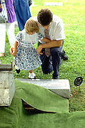 Father and daughter ages 34 and 4 at grave of great grandmother.  Cambria Wisconsin USA