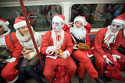 © under license to London News Pictures.  12/12/2010 Londoners dressed in Santa Claus costumes participate in 'SantaCon', a Santa-themed pub crawl across London yesterday (11/12/2010). Similar SantaCon events take place in various cities around the world, with an emphasis on having fun and spreading seasonal good cheer to passers by. Photo credit should read: London News Pictures