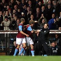 Photo: Mark Stephenson/Sportsbeat Images.<br /> Aston Villa v Tottenham Hotspur. The FA Barclays Premiership. 01/01/2008.Villa's Martin Laursen celebratres his winning goal with manager Martin O'Neill