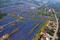 July 5, 2018 - Shanxi, China - Aerial photo taken on July 5, 2018 shows a photovoltaic power plant in Ruicheng County of Yuncheng City, north China's Shanxi Province. In recent years, the county has vigorously developed and utilized solar energy by building photovoltaic power plants on barren mountains. (Credit Image: © Cao Yang/Xinhua via ZUMA Wire)