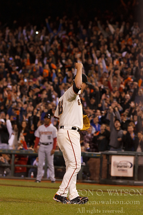 SAN FRANCISCO, CA - JUNE 13:  Matt Cain #18 of the San Francisco Giants celebrates after pitching a perfect game against the Houston Astros at AT&T Park on June 13, 2012 in San Francisco, California. The San Francisco Giants defeated the Houston Astros 10-0. (Photo by Jason O. Watson/Getty Images) *** Local Caption *** Matt Cain