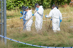 © Licensed to London News Pictures 21/09/2021. <br /> Kidbrooke, UK, Forensic search teams working this afternoon. A large police cordon is still in place around Cator Park at Kidbrooke Village in Kidbrooke, South East London today after the body of 28 year old school teacher Sabina Nessa was found near a community centre. Police believe Sabina was murdered by a stranger. Photo credit:Grant Falvey/LNP