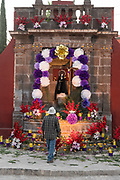 A Mexican man prepares a community altar celebrating El Viernes de Dolores during Holy Week at the Aldama fountain March 23, 2018 in San Miguel de Allende, Mexico. The event honors the sorrow of the Virgin Mary for the death of her son and is an annual tradition in central Mexico.