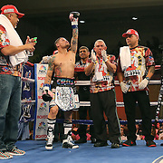 """Orlando """"El Fenomeno""""  Cruz raises his arm during introductions prior to his match against Gabino """"Flash"""" Cota during their Boxeo Telemundo WBO/NABO Super Featherweight bout on Friday, October 9, 2015 at the Kissimmee Civic Center in Kissimmee, Florida. Cruz, who is from Puerto Rico, is the first ever openly gay boxer  in the history of the sport and won the bout by unanimous decision.  (Alex Menendez via AP)"""