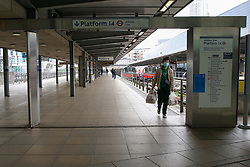 © Licensed to London News Pictures. 15/03/2020. London, UK. A man wearing a face mask on an empty platform at Stratford station amid an increased number of coronavirus (COVID-19) cases in the UK. 21coronavirus victims have died and 820 cases have tested positive of the virus in the UK of which 167 in London. Photo credit: Dinendra Haria/LNP