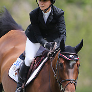 Georgina Bloomberg riding Washington Square in action during the $35,000 Grand Prix of North Salem presented by Karina Brez Jewelry during the Old Salem Farm Spring Horse Show, North Salem, New York, USA. 15th May 2015. Photo Tim Clayton