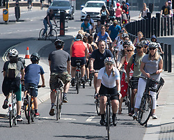 © Licensed to London News Pictures. 09/05/2020. London, UK. Cyclists gather at traffic lights entering Parliament Square in Westminster, London, during lockdown. The government is set to announce measures to ease lockdown, which was introduced to fight the spread of the COVID-19 strain of coronavirus. Photo credit: Ben Cawthra/LNP