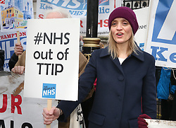 © Licensed to London News Pictures. 30/11/2015. London, UK. Actress Anne-Marie Duff joins National Health Service workers and other supporters in protest against the National Health Service (NHS) being part of the Transatlantic Trade and Investment Partnership (TTIP) agreement at the gates of Downing Street. Photo credit: Peter Macdiarmid/LNP