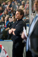 KELOWNA, CANADA - JANUARY 7: Scott Hoyer, athletic therapist of the Kelowna Rockets stands on the bench against the Vancouver Giants on January 7, 2015 at Prospera Place in Kelowna, British Columbia, Canada.  (Photo by Marissa Baecker/Shoot the Breeze)  *** Local Caption *** Scott Hoyer;
