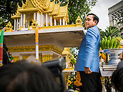 09 SEPTEMBER 2014 - BANGKOK, THAILAND: Thai Prime Minister GENERAL PRAYUTH CHAN-OCHA walks around the shrine while praying at a Buddhist shrine on the grounds of Government House in Bangkok. Thai Prime Minister General Prayuth Chan-ocha named a cabinet that was dominated by members of the security forces to govern Thailand through at least a year of political reforms before elections are held. Prayuth and the cabinet met for the first time Tuesday. Before the meeting Prayuth said a prayer at a Buddhist shrine on the grounds of Government House, which is the Prime Minister's office. Prayuth seized power in a military coup in May. He was unanimously selected as Prime Minister by the National Legislative Assembly (NLA), the acting parliamentary body. Prayuth and his aides personally selected the members of the NLA after they seized power.       PHOTO BY JACK KURTZ