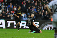 Man city's Aleksandar Kolorov  (on ground) celebrates after  he scores his sides 3rd goal.  Barclays Premier league, Swansea city v Manchester City at the Liberty Stadium in Swansea,  South Wales on  New years day Wed 1st Jan 2014 <br /> pic by Andrew Orchard, Andrew Orchard sports photography.